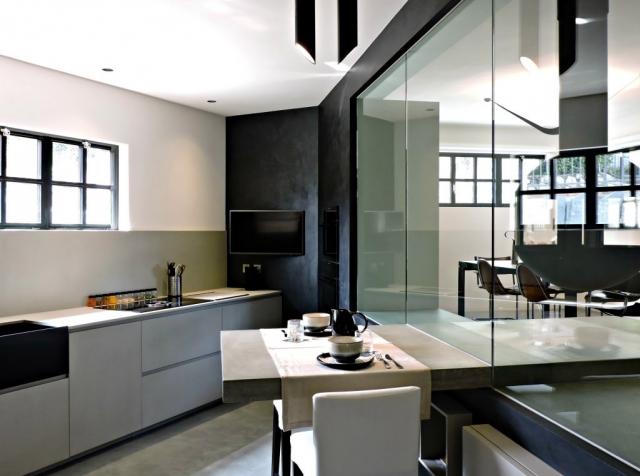 Loft ad Agno: cucina in cemento